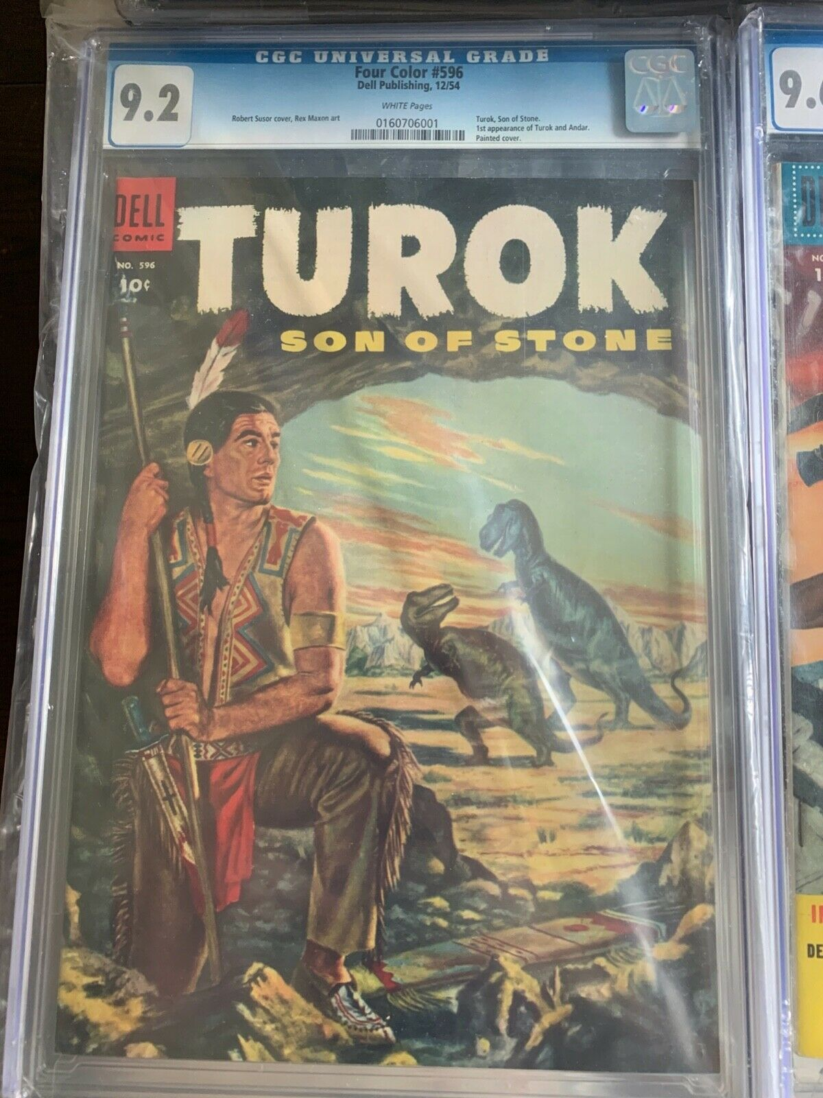Four Color 596 CGC 92 NM 1st Turok Son of Stone Dell OFF WHITE 121954